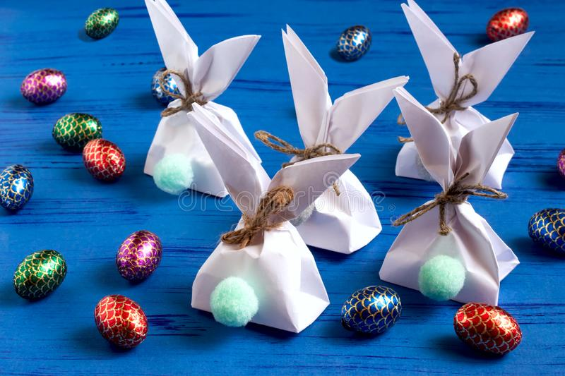 How to make package for sweets in form of Easter bunny. Step 6. How to make package for sweets in form of Easter bunny. Children`s art project. DIY concept. Step stock photos