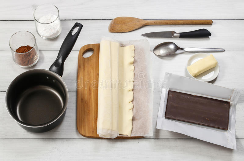 How to make palmier biscuits - french cookies. Made of puff pastry and chocolate (also called palm leaves, elephant ears, french hearts, shoe-soles or glasses stock photo