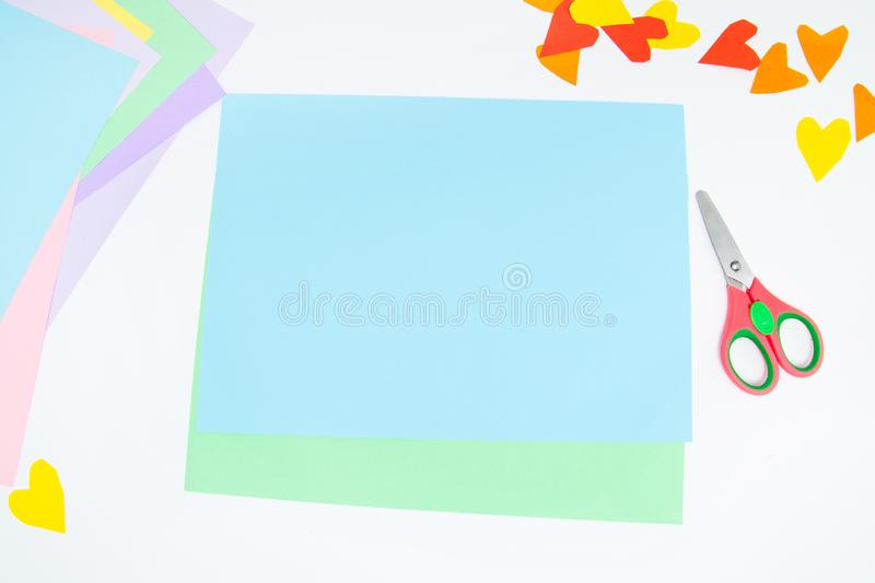 How to make paper bunny for Easter greetings and fun. Children art project. DIY concept. Kids hands makes paper craf. Step by step. Photo instruction. Step 1 stock images