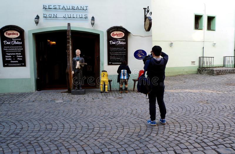 How to make a photoset. A couple making photo set in front of a restaurant royalty free stock images