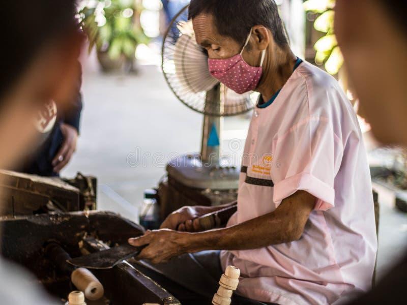 How to make umbella at bosang-umbella chiang mai. Old people make umbella at chiang mai royalty free stock image