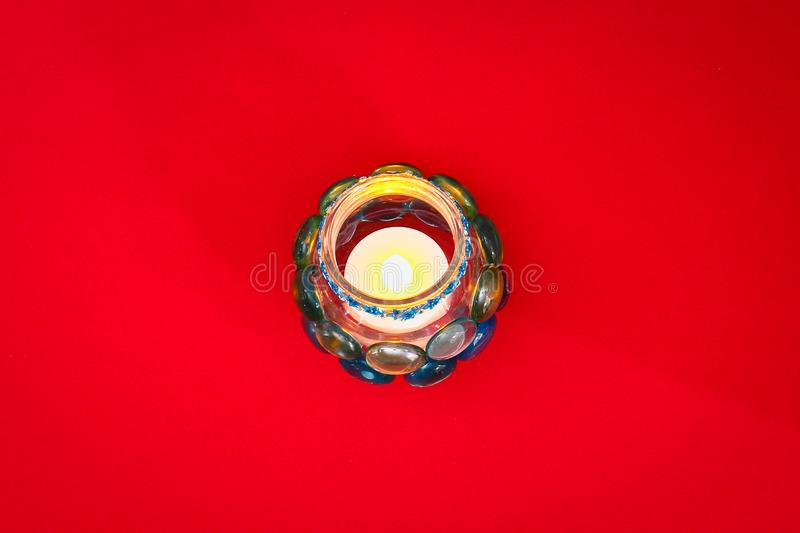 How to make your own candlestick from unnecessary glass or plastic and glass pebbles. Step by step. Christmas interior decor. How to make your own candlestick royalty free stock photo