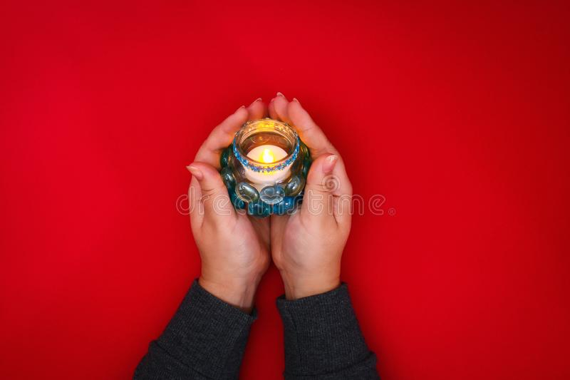 How to make your own candlestick from unnecessary glass or plastic and glass pebbles. Step by step. Christmas interior decor. How to make your own candlestick royalty free stock photography