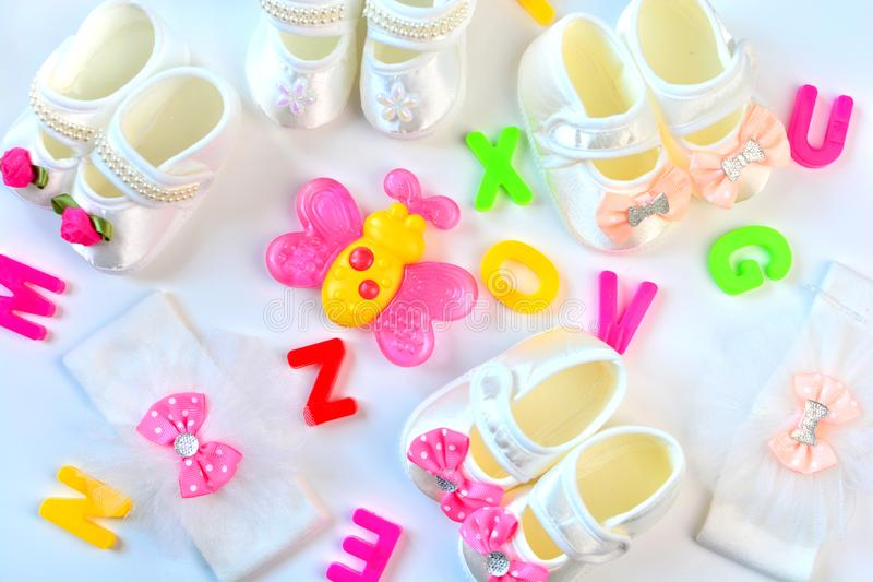 How to name a child. Concept with baby accessories and colorful letters. Flat lay royalty free stock photography