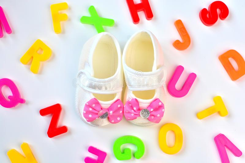 How to name a child. Concept with baby booties and colorful letters.  stock photos
