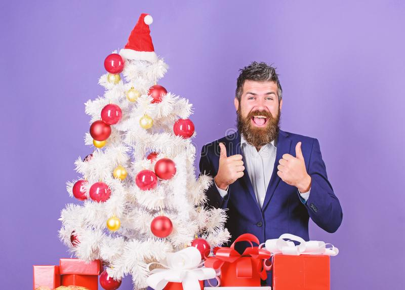 How to organize awesome office christmas party. Man bearded hipster wear formal suit near christmas tree. Checklist stock images