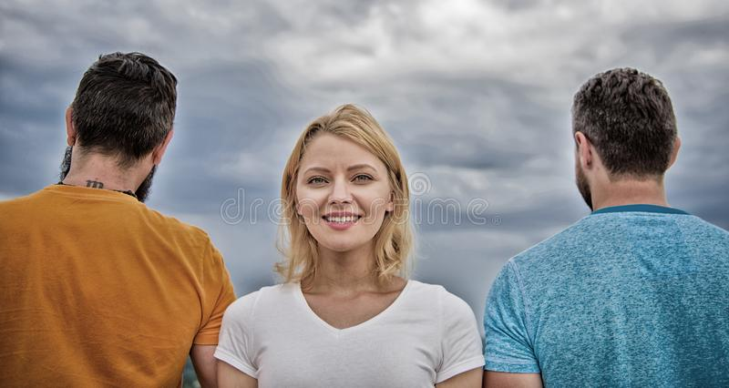 How to pick better boyfriend. Girl stand in front two faceless men. Girl thinking whom she going ask dating. Everything royalty free stock photos