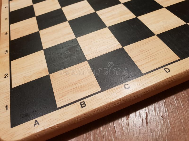 How to play wooden board game chess. Improvisation and Different angles of chess sets, pieces and chessboard. White and black figu stock images