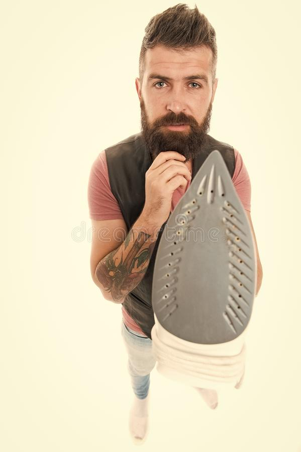 How to properly use steam iron. Man bearded hipster hold electric ironing tool. How iron clothes correctly. Guy with. Iron on white background isolated. Tailor royalty free stock photography