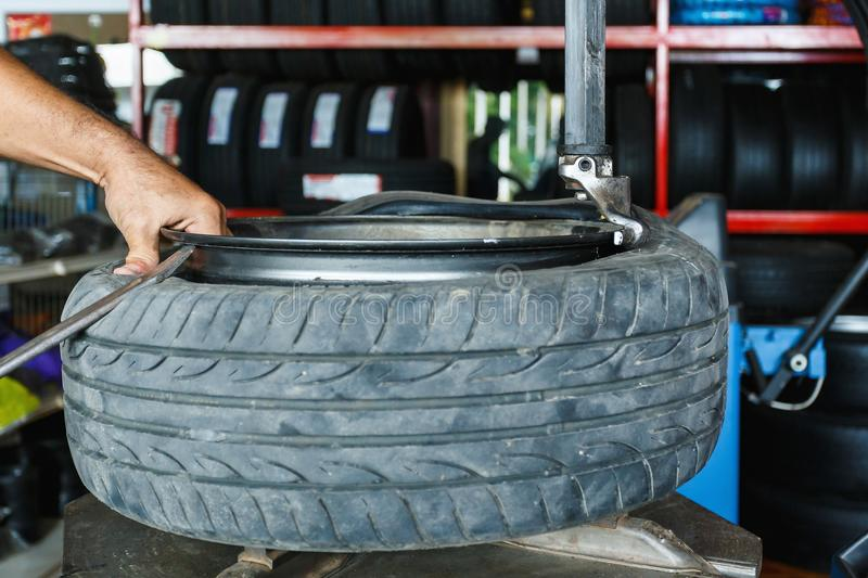 How to remove the tire from the car Alloy Wheels. royalty free stock photography