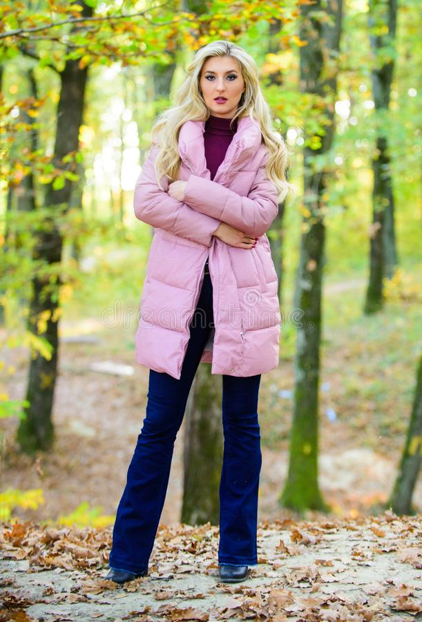How to rock puffer jacket like star. Fall fashion concept. Outfit prove puffer coat can look stylish. Jackets everyone royalty free stock photography
