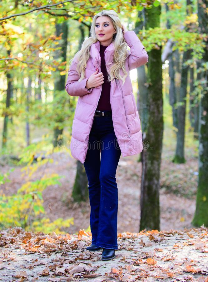 How to rock puffer jacket like star. Puffer fashion concept. Outfit prove puffer coat can look stylish. Girl fashionable stock images