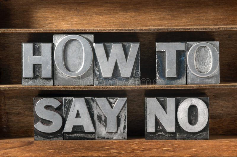 How to say no. Phrase made from metallic letterpress type on wooden tray royalty free stock photography