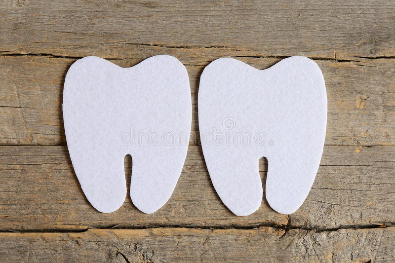 How to sew a felt tooth fairy. Step. Tutorial. Cut felt parts to create a felt tooth fairy. Felt tooth patterns. Felt tooth fairy photo. Felt crafts for kids stock image