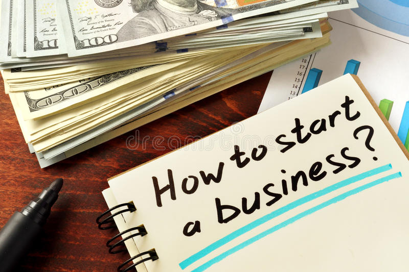 How to start a business. Concept. Notepad on the table stock photography