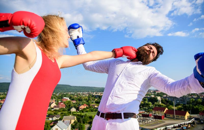 How to win her back effective tips. Let her win concept. Couple boxing gloves fight sky background. Girl confident. Strength power. Leadership family relations stock photo