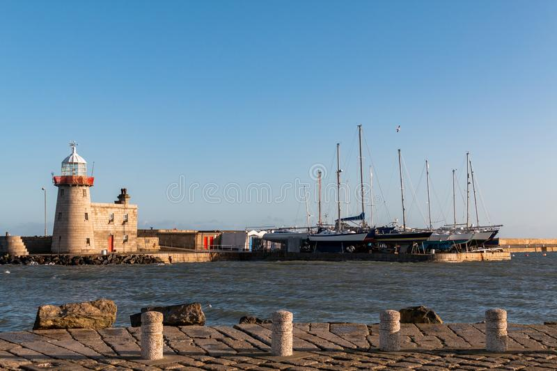 Howith Harbour Lighthouse, Dublin, Ierland stock foto