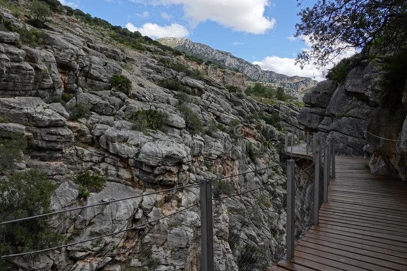Hoyo valley boardwalk at Caminito del Rey in Andalusia, Spain. The Caminito del Rey i or King`s little footpath s a cliff-side path hanging 100m above the waters stock photo