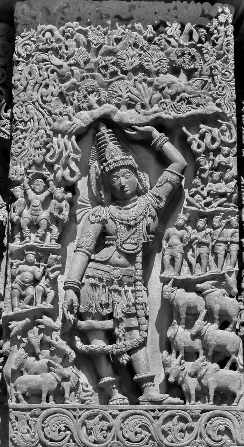 Hoysaleswara Temple: Krishna lifting the Govardhan mountain royalty free stock images