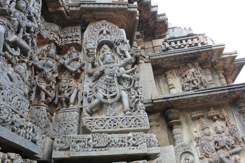 Hoysaleswara Temple outer wall carved with sculpture of Garuda, the humanoid bird stock photo