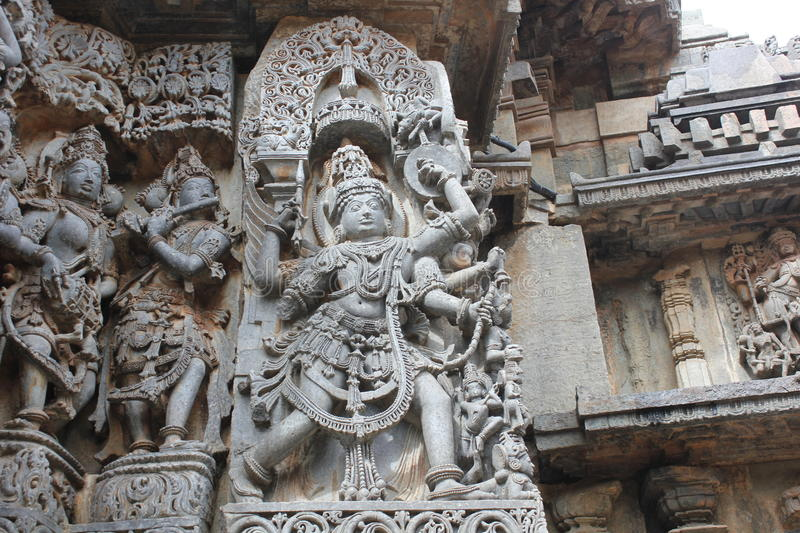 Hoysaleswara Temple outer wall carved with sculpture of Garuda, the humanoid bird royalty free stock photos