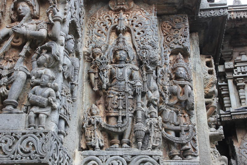 Hoysaleswara Temple Wall carved with sculpture of Lord Mahavishnu with his weapons sankh and chakra royalty free stock photos