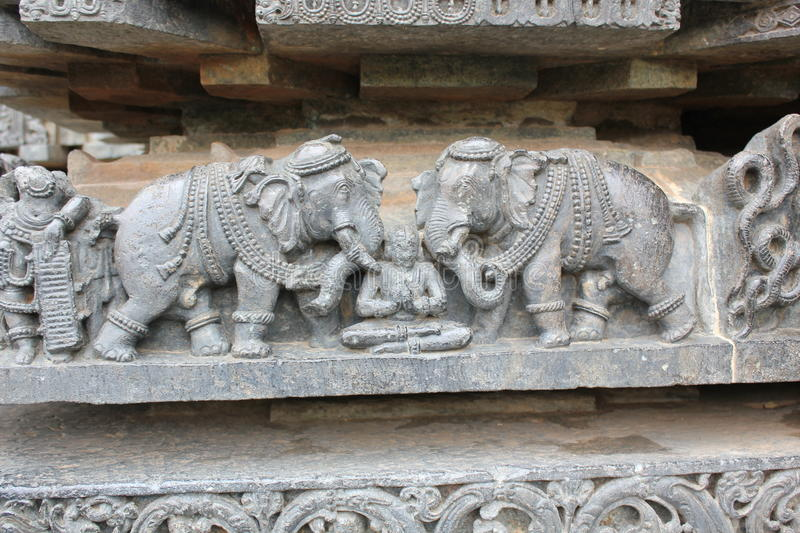 Hoysaleswara Temple Wall carved with sculpture of Prahlada attacked by elephants royalty free stock photography