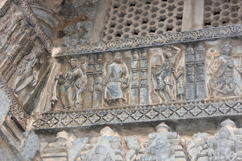 Hoysaleswara Temple wall carving of various dancers and dance postures. This is wall carving of various dancers and dance postures. This carving is in stock image