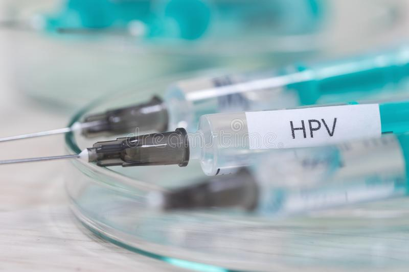 Hpv vaccination syringe background. An hpv vaccination syringe background royalty free stock images
