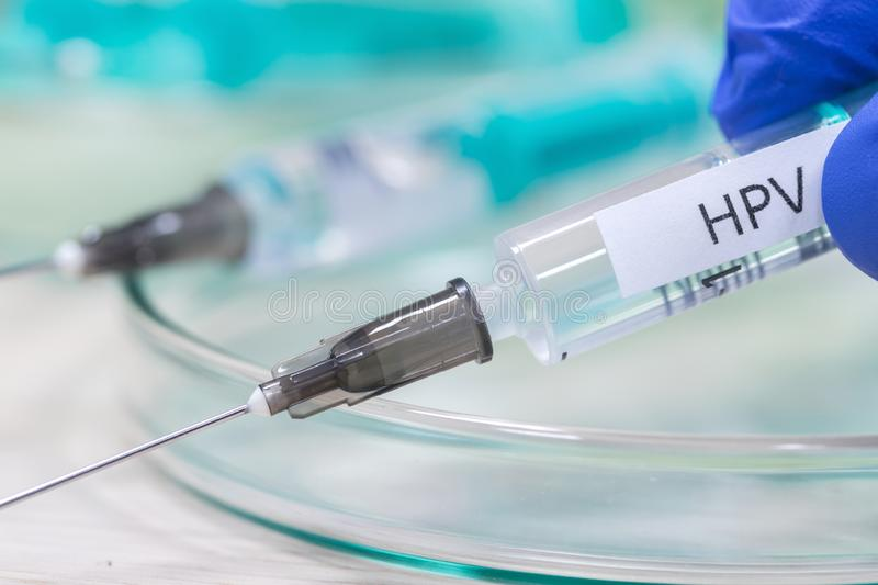 Hpv vaccination syringe background. An hpv vaccination syringe background royalty free stock photos