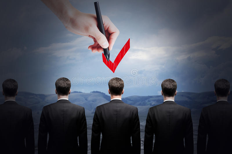 HR and choice concept. Hand choosing best candidate by ticking him with red checkmark. HR and choice concept stock images