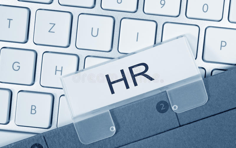 HR - Human Resources - folder with text on computer keyboard stock photography