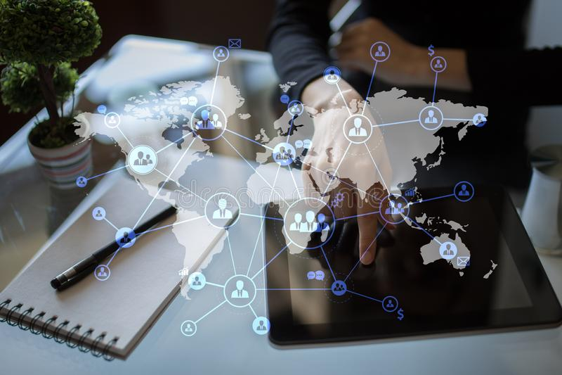 HR, human resources management. CRM - Customer relationship management. International Outsourcing on virtual screen. stock photo