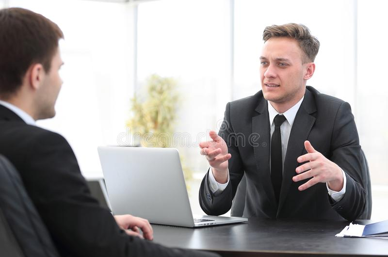 Senior Manager conducts the interview with the new employee stock images