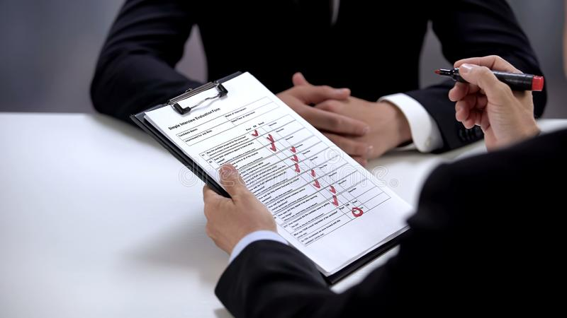 HR manager filling data in job interview form, testing candidate before hiring stock images