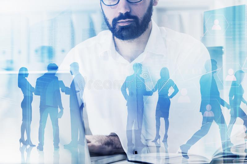 HR manager in office, social network. Serious bearded HR manager working in office. Double exposure of business people and social network interface. Concept of stock images