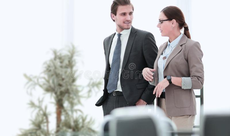 HR Manager is talking to the new employee. stock photos