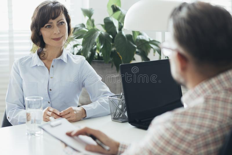 HR manager trying to increase employee motivation. HR manager trying to increase an employee motivation stock images