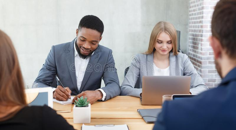 Hr managers interviewing job applicants, making notes stock photo