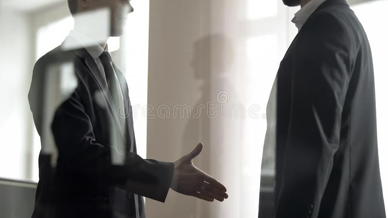 HR officer greeting applicant, job search in large companies, view through glass. Stock photo stock photos