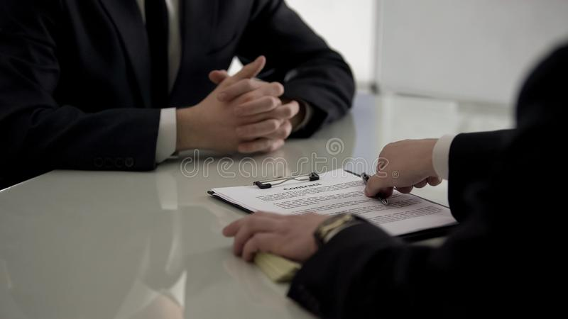 HR officer offering employment contract to job applicant, promotion assignment. Stock photo stock photos