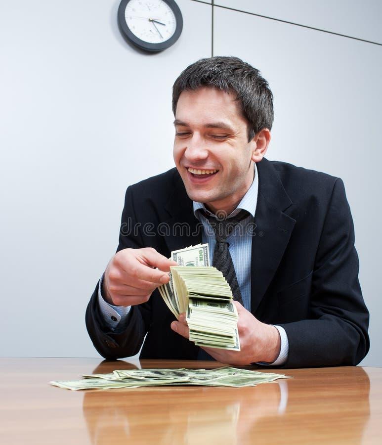 hrabiowscy biznesmenów dolary sto jeden paczki zdjęcie stock