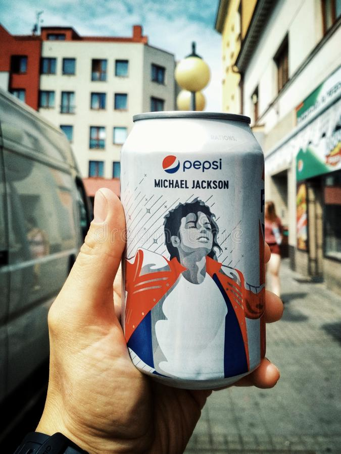 HRADEC KRALOVE, CZECH REPUBLIC - AUGUST 12, 2018: Pepsi can with Michael Jackson in hand. Limited Edition. City background royalty free stock images