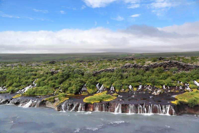 Hraunfossarwaterval, IJsland stock afbeeldingen