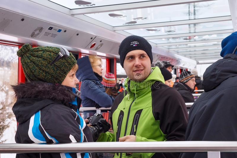 HREBIENOK, SLOVAKIA - JANUARY 07, 2015: Unknown people inside the funicular car in the High Tatras mountains National park. stock photo