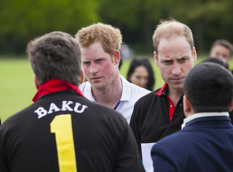 HRH Prince William and HRH Prince Harry competes in Polo match. Berkshire, United Kingdom-May 11, 2014 :HRH Prince William and HRH Prince Harry competes in the royalty free stock image