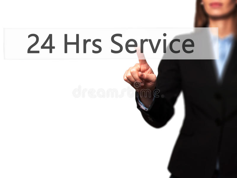 24 Hrs Service - Isolated female hand touching or pointing to bu. Tton. Business and future technology concept. Stock Photo royalty free stock images