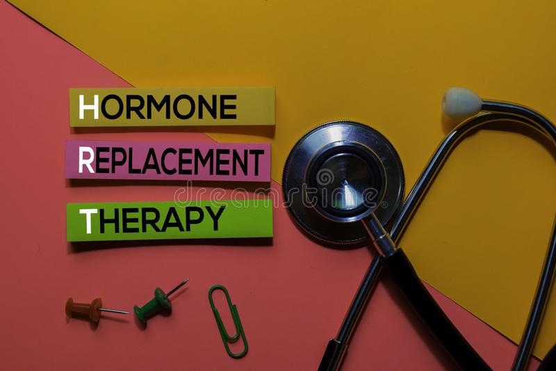 HRT. Hormone Replacement Therapy acronym on sticky notes. Office desk background stock photos
