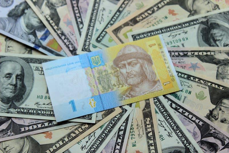 Hryvnia e notas de dólar ucranianos Fundo do dinheiro imagem de stock royalty free