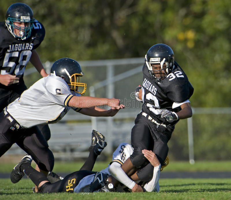 HS American Football tackle stock images